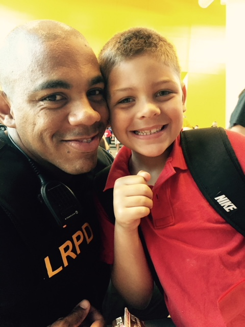 Back in September, this boy's father died, cutting short a career in public service. Little Rock Police Sergeant Cedric Roy lost his battle to cancer.