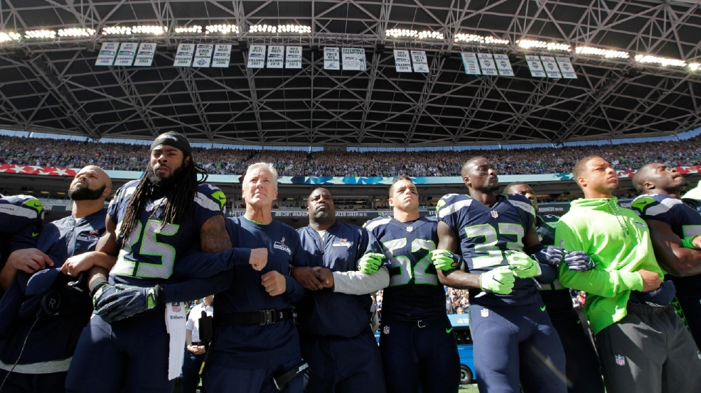 Image result for seahawks kneeling