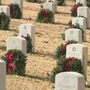 Volunteers lay Christmas wreaths on veterans graves in Little Rock
