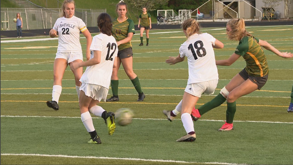 Reynolds junior forward Addie Porter [green jersey, left] fires a shot on goal during the 2019 season (WLOS Staff).PNG