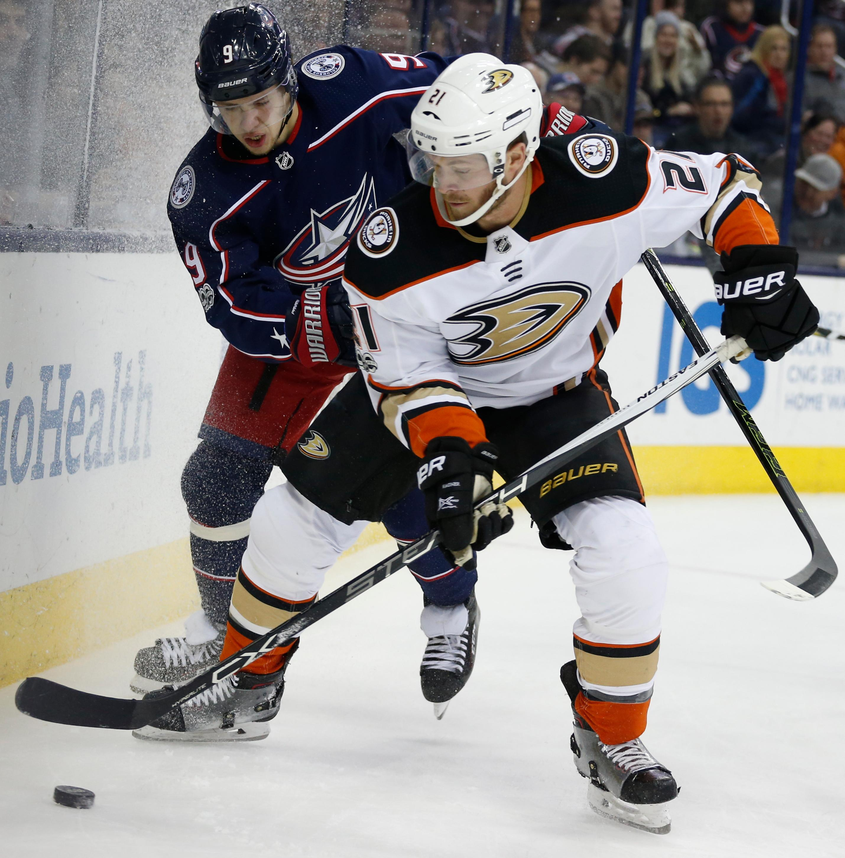 Anaheim Ducks' Chris Wagner, right, clears the puck in front of Columbus Blue Jackets' Artemi Panarin, of Russia, during the first period of an NHL hockey game Friday, Dec. 1, 2017, in Columbus, Ohio. (AP Photo/Jay LaPrete)
