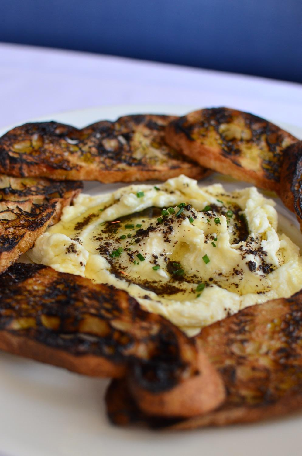 Whipped Ricotta: grilled baguette, truffle, honey, EVOO / Image: Leah Zipperstein, Cincinnati Refined
