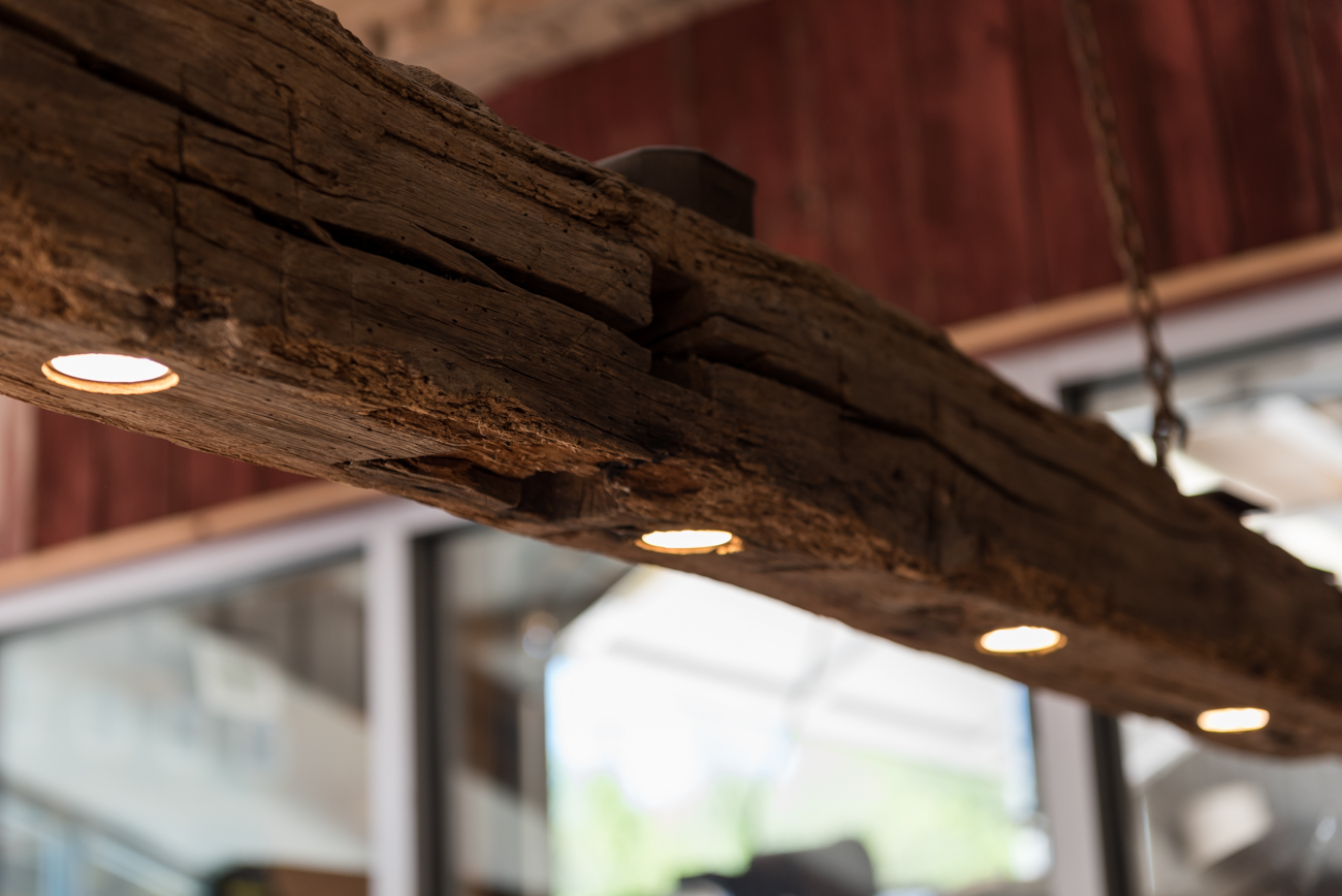 Reclaimed wood from the farm's property was used to renovate an old barn into the brewery, as well as pieces of furniture in the taproom. Jael's dad is a blacksmith who created all the metal work in the structure, as well. / Image: Mike Menke // Published: 6.13.19<p></p>