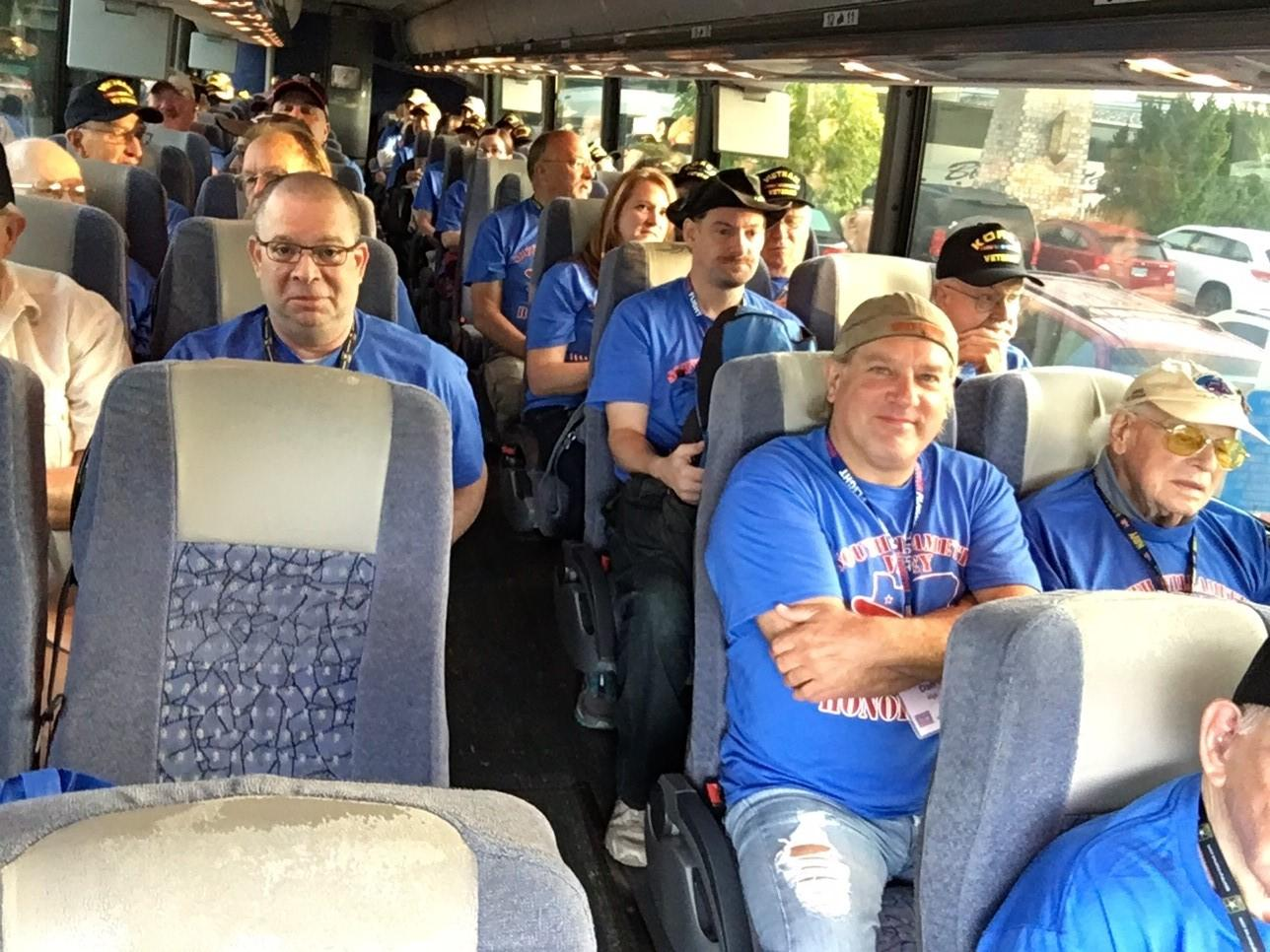 The veterans boarded buses en route to the Portland Airport, then flew to Reagan International in Washington, D.C., on Friday. (SBG)