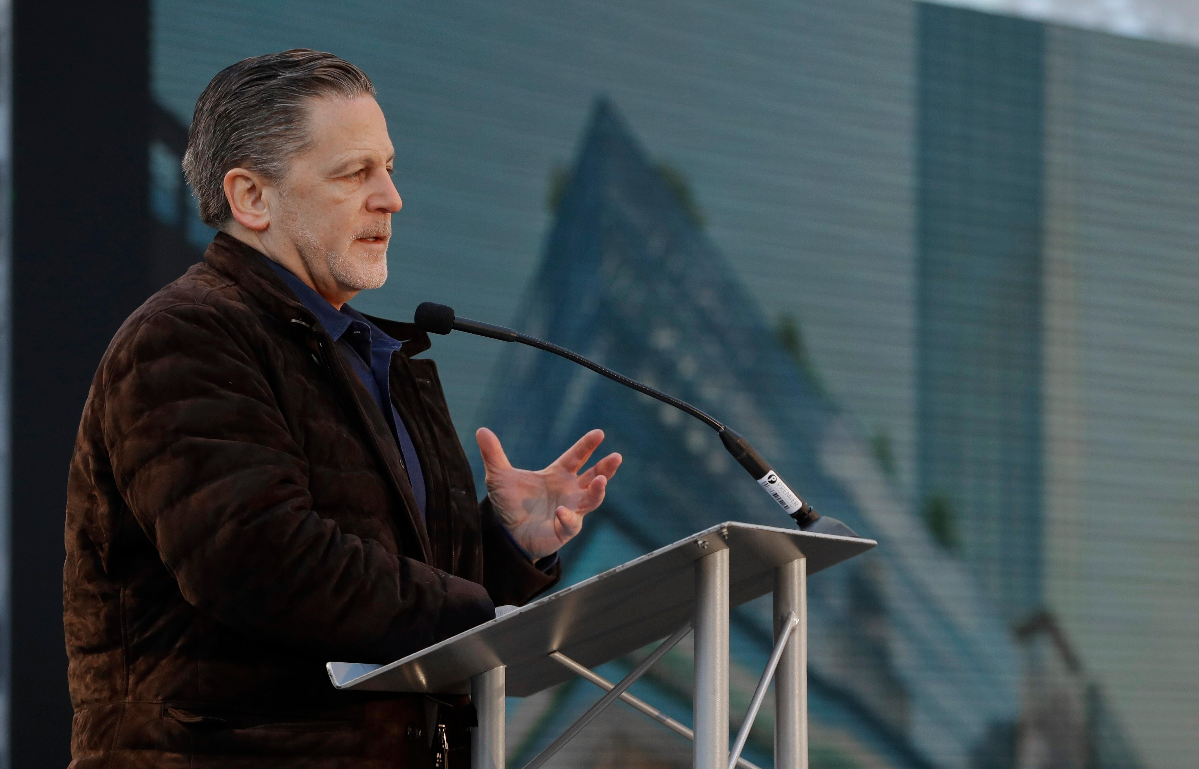 Quicken Loans founder Dan Gilbert, addresses attendees at the former site of the J.L. Hudson Co. department store, Thursday, Dec. 14, 2017, in Detroit. Ground was broken for a new 800-foot-tall, $900 million two-building project that will include a 58-story residential tower and 12-floor building for retail and conference space. The tower will have an 800-foot-tall (244-meter) sky deck.(AP Photo/Carlos Osorio)