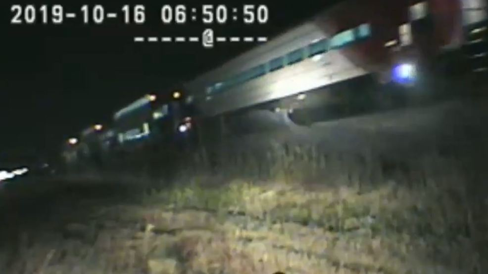 INTENSE VIDEO UHP trooper risks life to save driver stranded on train tracks UHP (1).JPG