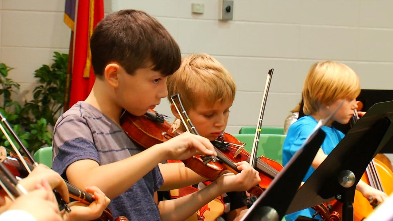 Some Hall Fletcher students are involved in the MusicWorks program that meets every afternoon after school for three hours. (Photo credit: WLOS staff)