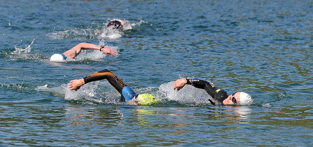 Leaders make a turn into the 2nd loop of the swim portion of the Granite Man Triathlon Saturday at Applegate Lake.