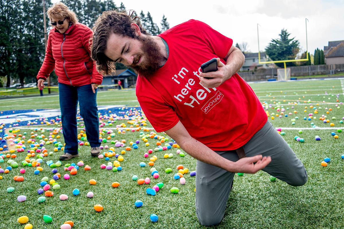 Volunteers spread the eggs out before the unleash the kids on them. Hundreds of kids from young babies to school age converged on Marist High School on Saturday for a helicopter Easter egg drop. The event, put on by Joy Church, loaded up a large bucket with eggs then dropped it across the Marist football field by helicopter. Photo by Rhianna Gelhart, Oregon News Lab