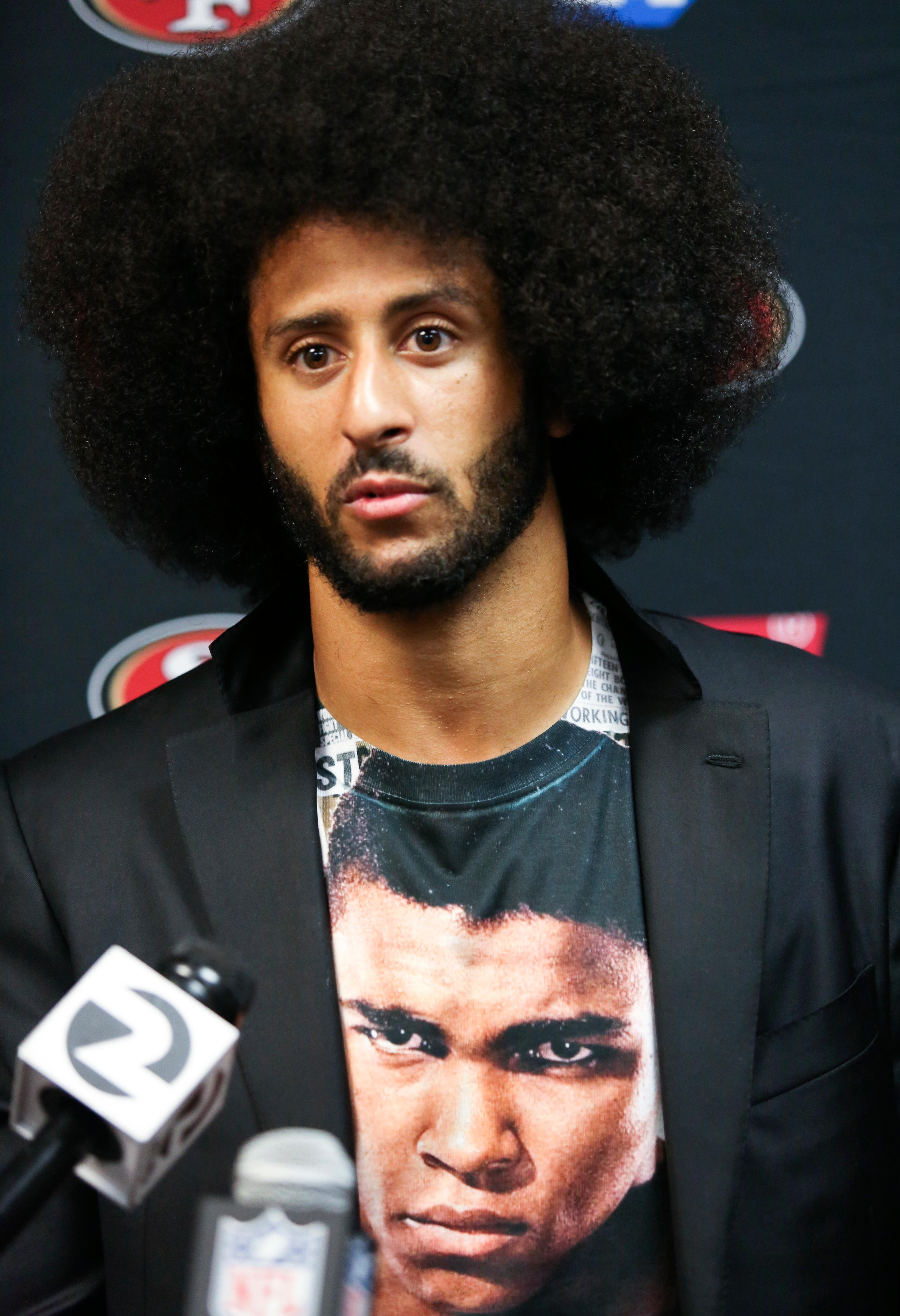 FILE - In this Oct. 16, 2016, file photo, San Francisco 49ers quarterback Colin Kaepernick talks with the media after an NFL football game against the Buffalo Bills in Orchard Park, N.Y. What started as a protest against police brutality has mushroomed a year later into a divisive debate over the future of Kaepernick who refused to stand for the national anthem and now faces what his fans see as blackballing for speaking out in a country roiled by racial strife. The once-rising star and Super Bowl quarterback has been unemployed since March, when he opted out of his contract and became a free agent who could sign with any team. (AP Photo/Jeffrey T. Barnes, File)