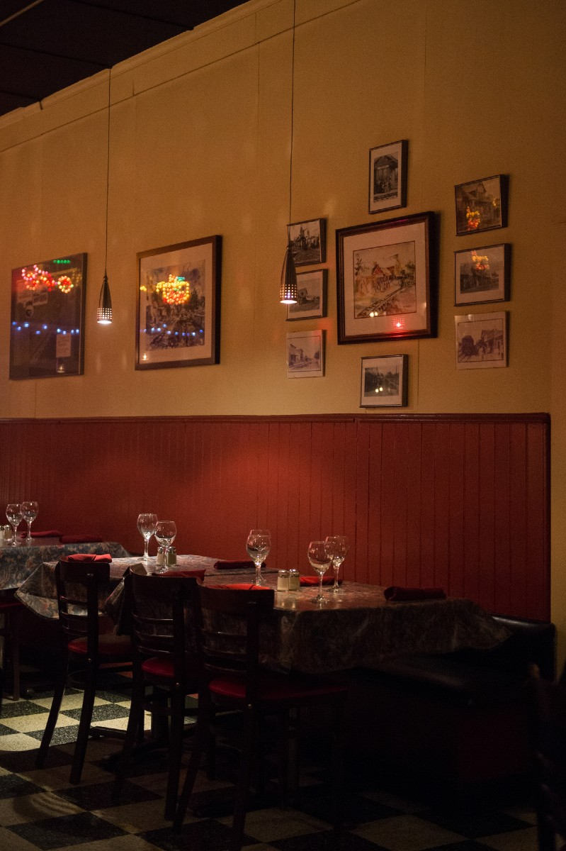 Interior of the warm and inviting dining area. Located in a historic train depot, you'll spy one or two of the chef's framed photos frmo his personal adventures adorning the walls of the space. (Image: Chona Kasinger / Seattle Refined)