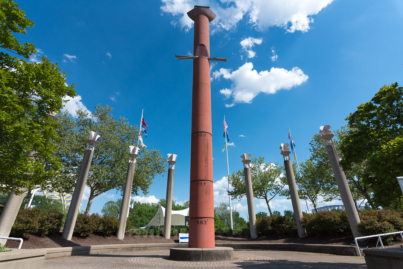 A flood column made of red cement has markings where historic flood waters have risen with their corresponding dates. A miniature Noah's Ark sits at the top of the structure. Homer and the Guentter team erected this column. / Image: Phil Armstrong, Cincinnati Refined // Published: 5.15.18