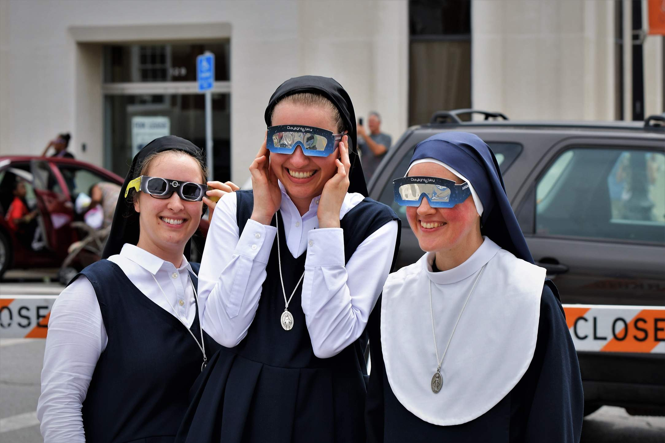Local nuns prepare for the eclipse at the Independence Square. [David M. Rainey/Special to The Examiner]
