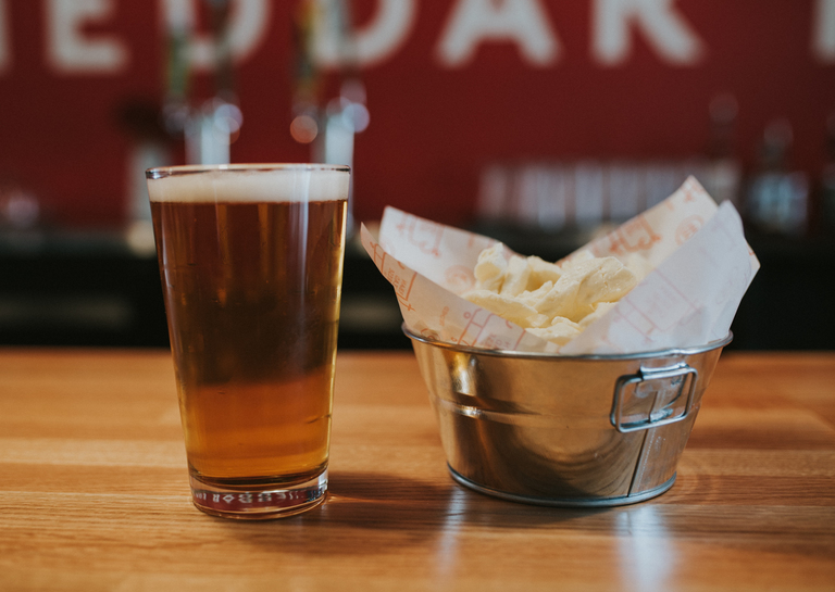 Fresh Urban Stead cheddar curds with Braxton Brewing Co. Storm / Image: Brianna Long // Published: 4.11.18
