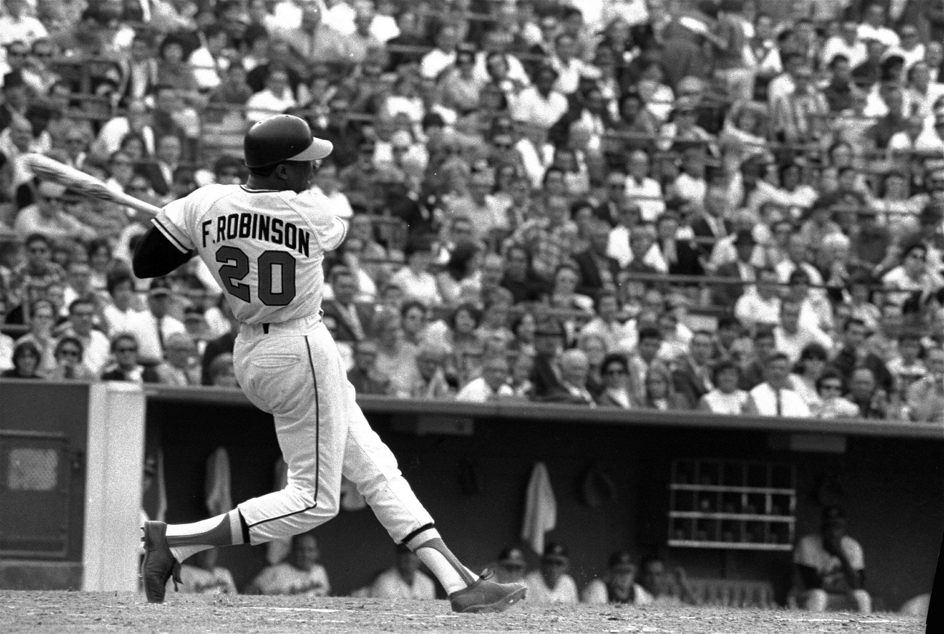 FILE -This is a May 19, 1966, file photo showing Baltimore Orioles' Frank Robinson at bat. Hall of Famer Frank Robinson, the first black manager in Major League Baseball and the only player to win the MVP award in both leagues, has died. He was 83. Robinson had been in hospice care at his home in Bel Air. MLB confirmed his death Thursday, Feb. 7, 2019.(AP Photo/File)