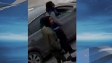 Man robbed at gunpoint inside his car, police looking for suspects