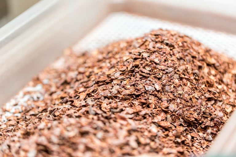 To separate the shell and husk from the nib, ground cacao is sorted through several metal screens.  --  Image: Daniel Smyth Photography