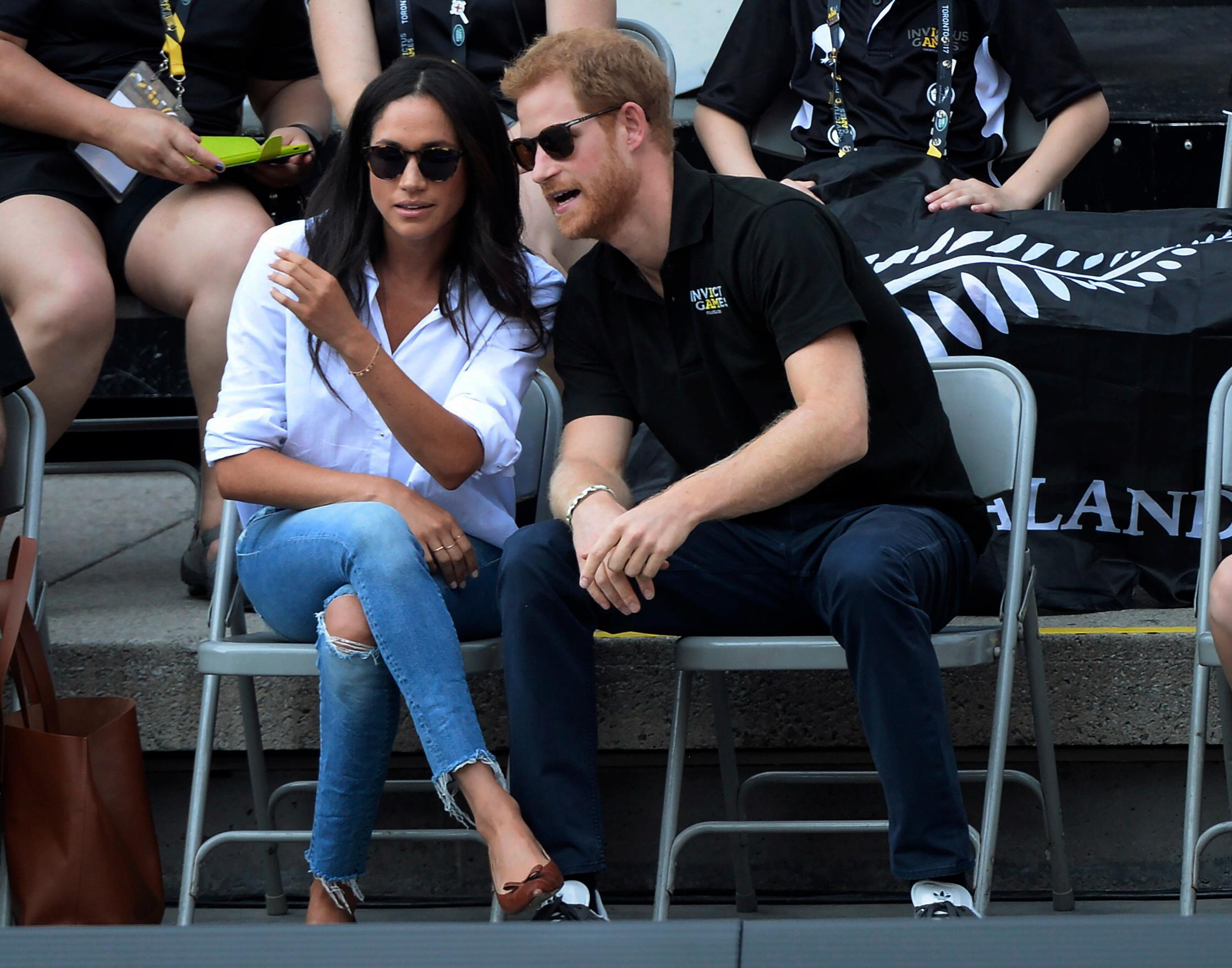 Prince Harry and his girlfriend Meghan Markle attend a wheelchair tennis event at the Invictus Games in Toronto, Monday, Sept. 25, 2017. (Nathan Denette/The Canadian Press via AP)