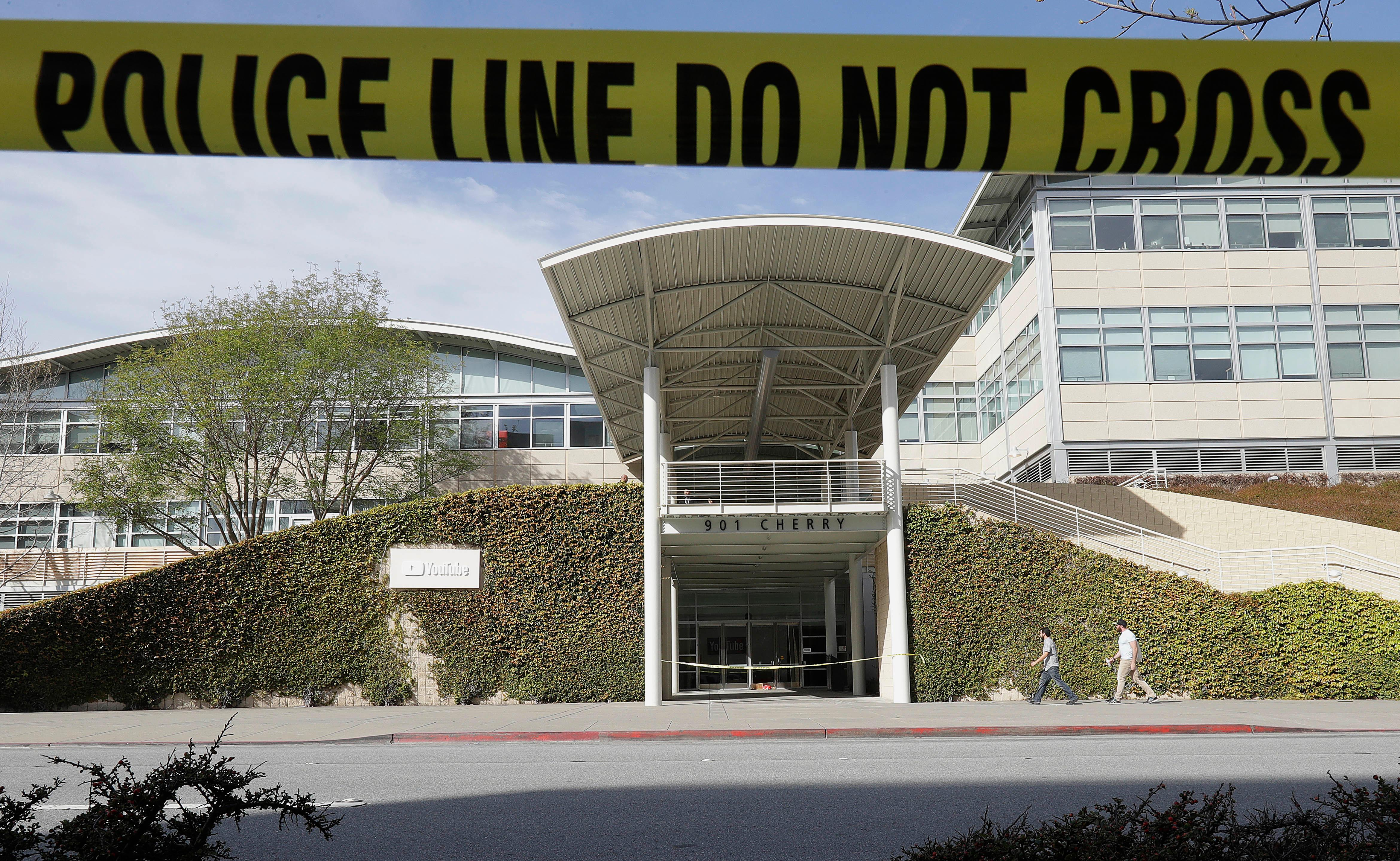 Police tape is shown outside of a YouTube office building in San Bruno, Calif., Wednesday, April 4, 2018. A woman suspected of shooting three people at YouTube headquarters before killing herself was furious with the company because it had stopped paying her for videos she posted on the platform, her father said Tuesday, April 3, 2018. (AP Photo/Jeff Chiu)