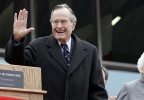 In this Dec. 7, 2009 file photo, former President George H.W. Bush and former first lady Barbara Bush arrive for a ceremony to dedicate an expanded gallery that carries his name at the National Museum of the Pacific War, in Fredericksburg, Texas.   (AP Photo/Eric Gay, File)