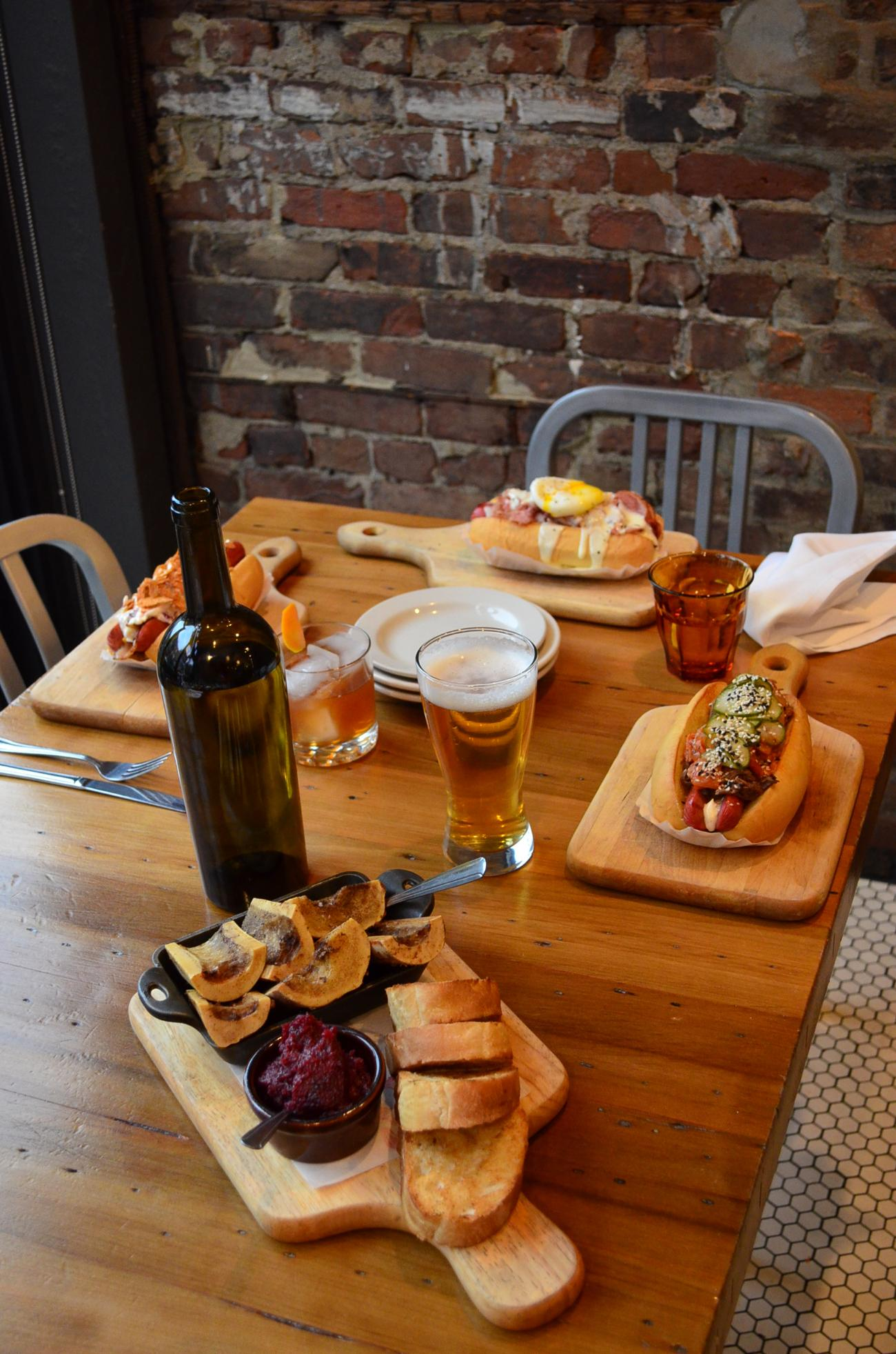 "PLACE: Senate Pub (OTR location) / ADDRESS: 1212 Vine Street (OTR) / EPISODE: Season 21, Episode 6: ""One Street Wonders"" / Senate Pub calls their fare ""gourmet street food,"" but Guy Fieri gives the massive, specialty hotdogs a catchier name: winner wieners. For the full Triple D experience, try the Korean hot dog with braised short rib, kimchi, and pickled cucumbers. / Image: Leah Zipperstein // Published: 8.18.19"