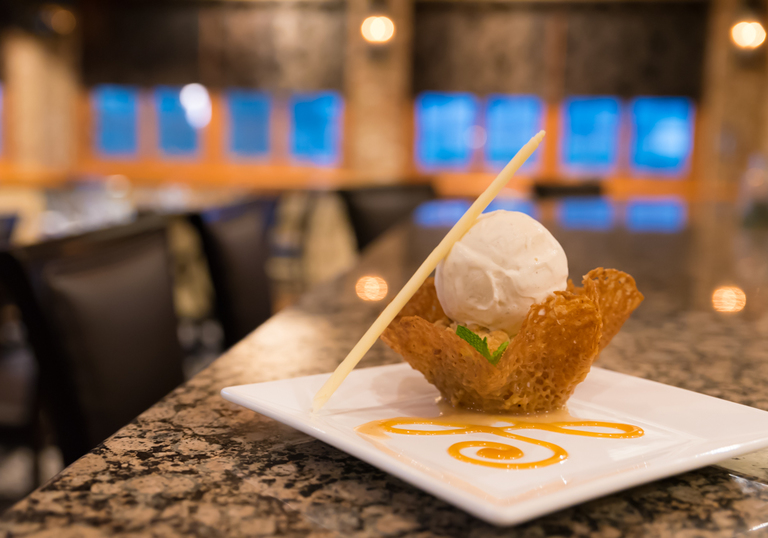Warm Apple Crisp: spiced apples baked with crumble topping in a pecan tuile cookie and topped with Tahitian vanilla gelato / Image: Sherry Lachelle Photography // Published: 3.21.18<br><p></p>