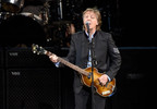 "FILE - In this July 26, 2017 file photo, Paul McCartney performs on the One on One Tour at the Hollywood Casino Amphitheatre in Tinley Park, Ill. Commuters with tickets to ride out of New York's Grand Central Station heard a special serenade on Friday evening, Sept. 7, 2018, with McCartney taking over a corner of the majestic hub for a concert. It was a stunt to promote a new album called ""Egypt Station."" (Photo by Rob Grabowski/Invision/AP, File)"
