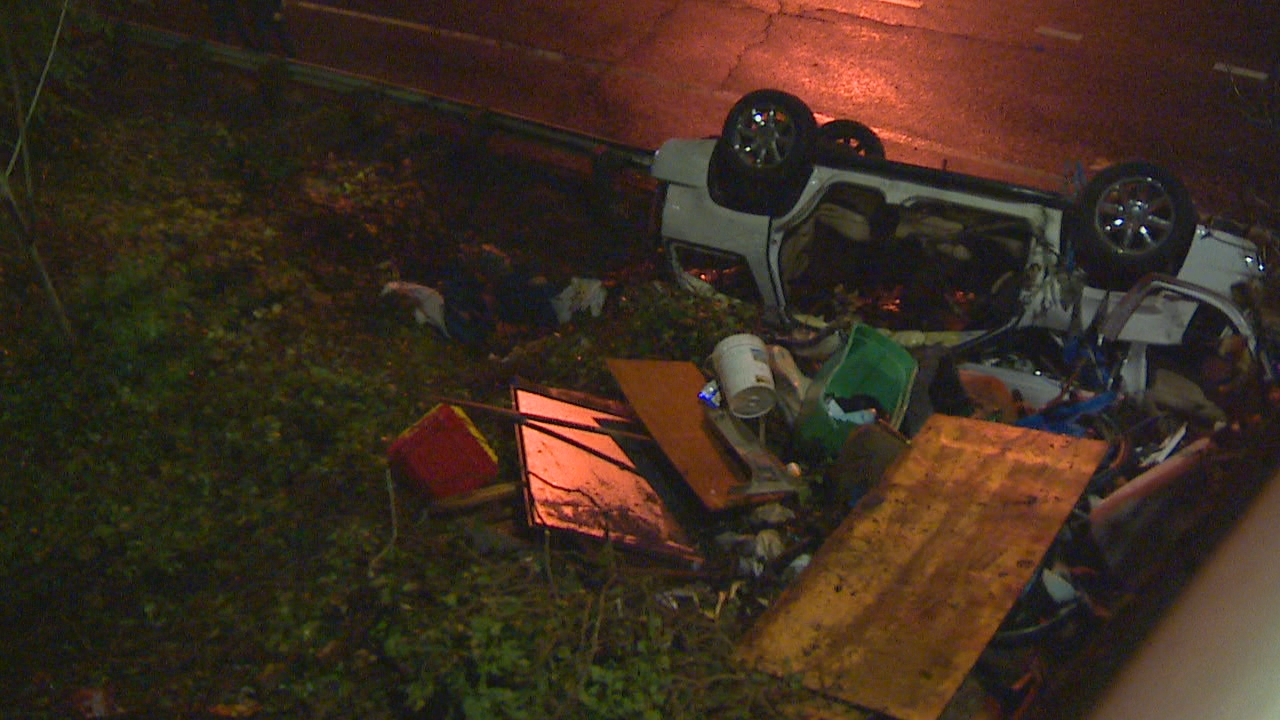 Seattle firefighters and medics work to rescue three people injured in a car crash near I-5. (KOMO Photo)