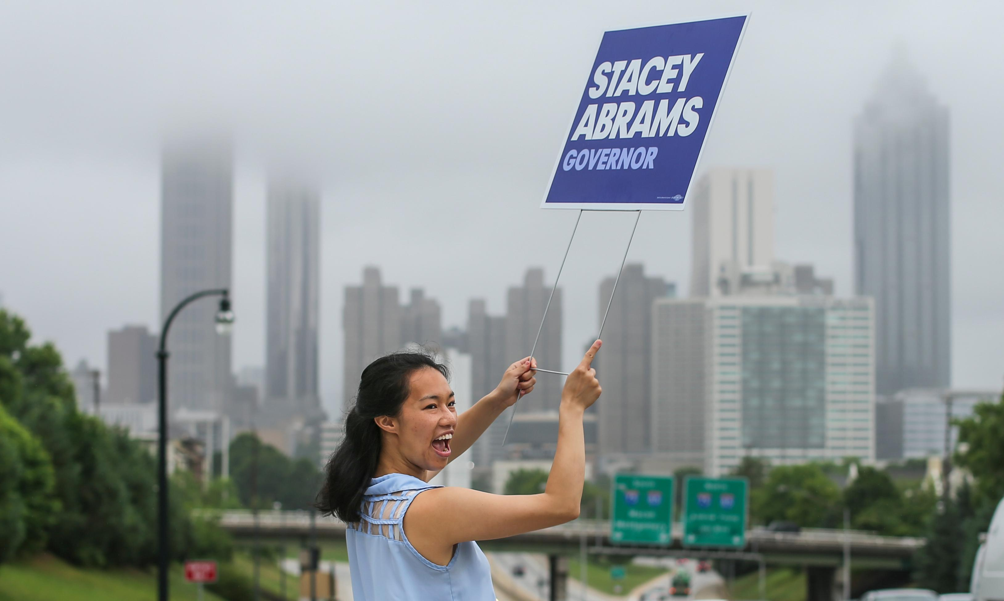 Mia Lei from Oakland, California chose Freedom Parkway and Boulevard to campaign for Gubernatorial candidate, Stacey Abrams on Tuesday May 22, 2018. Lei joined other Californians who came to Atlanta to campaign for Abrams. Voters across the state are reported to their regular precincts to{ }decide{ }on candidates for governor, Congress and statewide races in the Democratic and Republican primaries. (John Spink/Atlanta Journal-Constitution via AP)